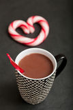 Hot chocolate and candy heart Stock Photos