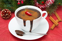 Hot chocolate with chili pepper and cinnamon and Christmas tinsel Stock Images