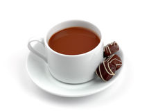 Hot Chocolate and Chocolates. Cup of hot chocolate with chocolates on the side Stock Photo