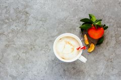 Hot chocolate and Christmas decor. Flat-lay of tangerines with leaves and hot chocolate with whipped cream - Image royalty free stock photos