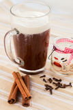 Hot Chocolate Christmas morning. Hot chocolate with cinnamon stick and clove Stock Photography