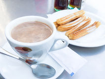 Hot chocolate with churros Stock Image
