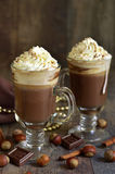 Hot chocolate with cinnamon and huzelnuts. Royalty Free Stock Images