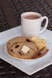 Hot chocolate and cinnamon raisin bread. Platter with hot chocolate and whole wheat cinnamon raisin bread with apple slices Stock Photos