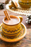 Hot chocolate with cinnamon in a rustic ware Stock Photo