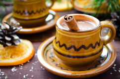 Hot chocolate with cinnamon in a rustic ware Royalty Free Stock Photo
