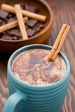 Hot chocolate with a cinnamon stick Stock Photos