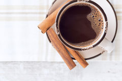Hot chocolate with cinnamon stick. Top view Stock Image