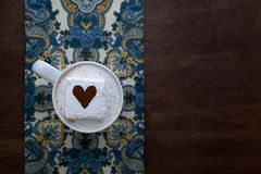 Hot Chocolate with Cocoa Dusted Heart Marshmallow Napkin and Wood Royalty Free Stock Image