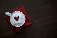 Hot Chocolate with Cocoa Dusted Heart Marshmallow on Red Napkin Stock Image