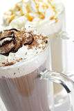 Hot chocolate and coffee beverages. Hot chocolate and coffee latte beverages with whipped cream Royalty Free Stock Photography