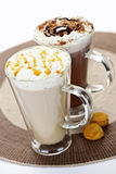 Hot chocolate and coffee beverages. Hot beverages of coffee and chocolate with whipped cream Royalty Free Stock Image