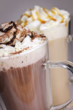 Hot chocolate and coffee beverages. Hot chocolate and coffee latte beverages with whipped cream Royalty Free Stock Images