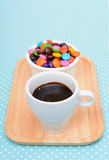 Hot chocolate and colorful candy Stock Photos