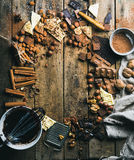 Hot chocolate cooking ingredients over rustic wooden background, copy space Royalty Free Stock Image