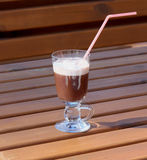 Hot chocolate with cream in a glass goblet Royalty Free Stock Photography