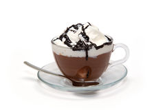 Hot chocolate with cream and syrup in glass cup Royalty Free Stock Image