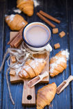 Hot chocolate with croissant. Vintage white cup with hot chocolate and fresh croissant in studio Stock Photo