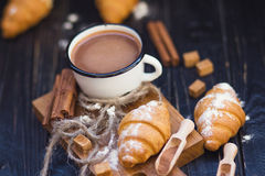 Hot chocolate with croissant. Vintage white cup with hot chocolate and fresh croissant in studio Royalty Free Stock Photography