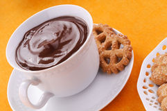 Hot chocolate in the cup and biscuits Stock Photo