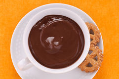 Hot chocolate in the cup with biscuits Stock Photography