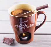 Hot chocolate cup with candle and biscuits Stock Photography