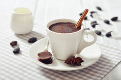 Hot Chocolate in cup. With cocoa powder and cinnamon stick on wooden background Stock Photography
