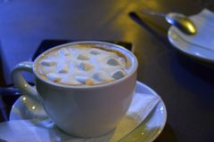 Hot chocolate cup with marshmallows at night Stock Images