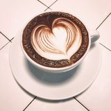 Hot chocolate. A cup of hot chocolate top up with white heart milk art Royalty Free Stock Photos