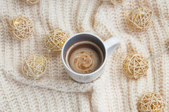 Hot chocolate cup with woolen sweater Stock Images