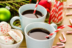 Hot chocolate. Cups with hot chocolate on wood table royalty free stock photography
