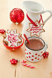 Hot chocolate and  decorated christmas cookies Royalty Free Stock Photos