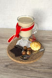 Hot chocolate and dessert. With cupcakes and chocolate on a wooden stand Stock Images