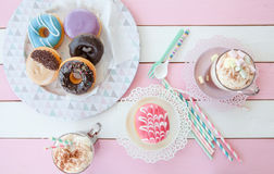 Hot chocolate and donuts Stock Images