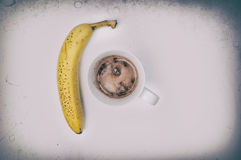 Hot chocolate drink and banana. Complete protein Hot Chocolate drink and a banana, isolated on white, overhead shot Royalty Free Stock Image