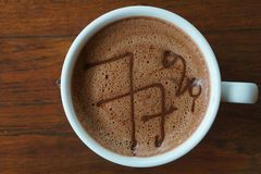 Hot chocolate drink. A cup of hot 77% dark cocoa drink stock photography