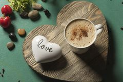 Hot Chocolate Drink on heart shaped wood green background word love stock photography