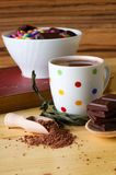 Hot chocolate drink next to bowl with sweets Royalty Free Stock Image