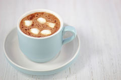 Hot chocolate drink in pastel bue cup Stock Image