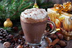 Hot chocolate drink topped with whipped cream. On a wooden background Stock Photo