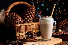 Hot chocolate drink with whipped cream. Cozy Christmas composition on a dark wooden background. Sweet treats for cold winter days. Hot chocolate drink with royalty free stock images