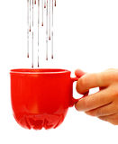 Hot chocolate dropping into coffee cup Royalty Free Stock Photo