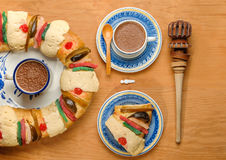 Hot Chocolate with Epiphany cake, Kings cake, Rosca de reyes or Roscon de reyes. Epiphany cake, Kings cake, Roscon de reyes or Rosca de reyes with Hot Chocolate Royalty Free Stock Images