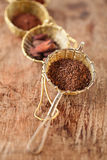 Hot chocolate flakes with chilli flavor in old rustic style silv. Er sieve, shallow dof Stock Photography