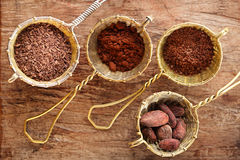 Hot chocolate flakes, grated chocolate, powder and cocoa beans Stock Photos