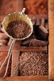 Hot chocolate flakes  in old rustic style silver sieve on wooden Stock Photography