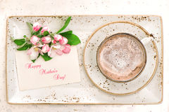 Hot chocolate with flowers. Cocoa drink with milk foam Stock Image