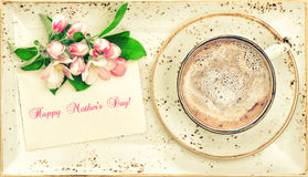 Hot chocolate with flowers and greetings card. Cocoa drink Royalty Free Stock Image