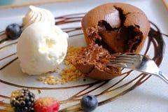 Hot Chocolate fondant with ice cream. Chocolate Lava Cake On White Plate royalty free stock photo