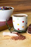 Hot chocolate in front of white bowl Stock Images